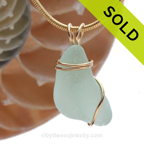 A stunning thick piece of vivid sea water green sea glass in a smaller necklace pendant. SOLD - Sorry this Rare Sea Glass Pendant is NO LONGER AVAILABLE!