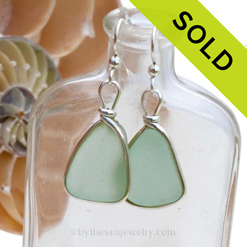 Soft Seafoam Green Sea Glass Earrings set in our Original Wire Bezel  Setting lets all the beauty of these beauties shine!  This setting does not alter the sea glass from the way it was found on the beach. SOLD - Sorry these Sea Glass Earrings are NO LONGER AVAILABLE!