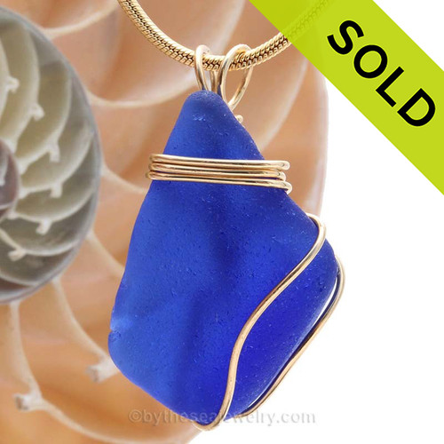 A LARGE curvy beautiful cobalt blue sea glass piece set in our tripled 14K Rolled Gold (goldfilled) setting. SOLD - Sorry this Rare Sea Glass Pendant is NO LONGER AVAILABLE!