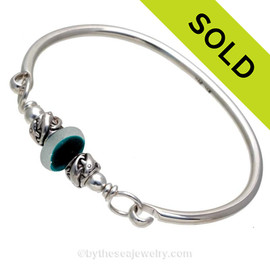 Vivid mixed teal beach found sea glass combined with real cultured pearls on this solid sterling silver FULL round sea glass bangle bracelet.  SOLD - Sorry this Sea Glass Bangle Bracelet is NO LONGER AVAILABLE!