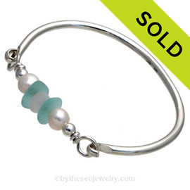 VIVID Aqua and Pure White Genuine Sea Glass Bangle Bracelet set with a Genuine Fresh Water TOP QUALITY Pearls and finished in sterling details on a Solid Sterling Round Bangle Bracelet. SOLD - Sorry this Sea Glass Bangle Bracelet is NO LONGER AVAILABLE!