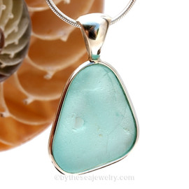 This is a LARGE Crizzled and Dimpled Aqua Blue Sea Glass set in our Original Wire Bezel© pendant setting in Sterling Silver .