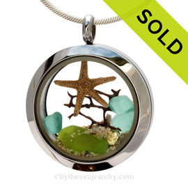 Genuine lime green and small aqua sea glass piece combined with a small REAL sstarfish a real beach sand in this stainless steel locket. SOLD - Sorry this Sea Glass Locket is NO LONGER AVAILABLE!