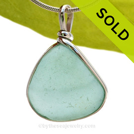 This is a beautiful Paler Aqua Blue Sea Glass set in our Original Wire Bezel© pendant setting in Sterling Silver. SOLD - Sorry this Rare Sea Glass Pendant is NO LONGER AVAILABLE!