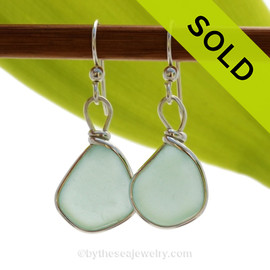 Genuine beach found pale aqua green sea glass earrings in a Solid Sterling Silver Original Wire Bezel setting. SOLD - Sorry these Rare Sea Glass Earrings are NO LONGER AVAILABLE!