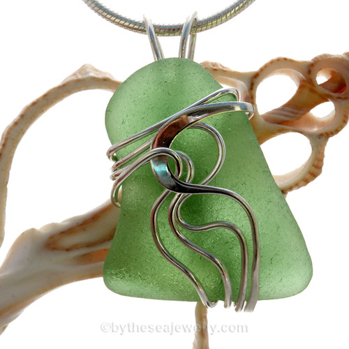 A stunning greena Genuine Sea Glass Pendant set in our Signature Waves© setting in Sterling Silver.