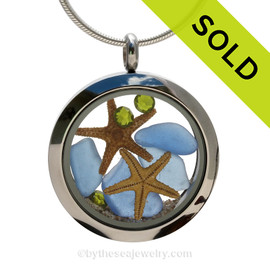 Genuine Carolina Blue Sea Glass Locket with a small REAL starfish a real beach sand in this stainless steel locket. Finished with a vivid peridot crystal gems for a bit of beachy bling. SOLD - Sorry this Sea Glass Locket is NO LONGER AVAILABLE!