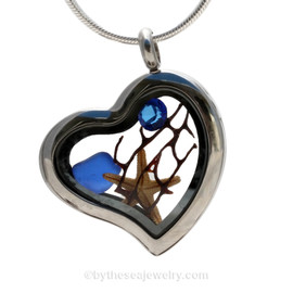 Beautiful pieces cobalt blue sea glass combined with a real starfish. Finished with Bright Blue Crystal gem in this Genuine Sea Glass Heart Locket Necklace.
