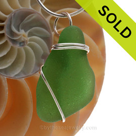 A nice piece of genuine perfect  sea glass in bright green and a simple secure  wire wrapped sterling setting. SOLD - Sorry this Sea Glass Pendant is NO LONGER AVAILABLE!