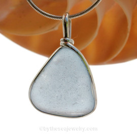 This is a beautiful LARGE Baby Blue Sea Glass set in our Solid Sterling Original Wire Bezel© pendant setting .