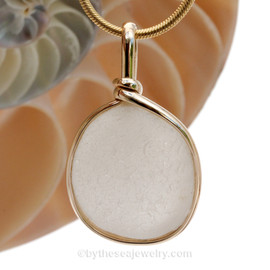A large pure white natural sea glass piece set in our Original Wire Bezel setting in 14K Rolled Gold setting. Shown here on our 1.6MM snake chain which is available as an upgrade.