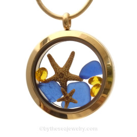 A gold tone stainless steel locket necklace with cobalt blue found sea glass pieces and two real starfish and finished with topaz crystal gems.
