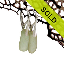 Two slender pieces of pale olive green sea glass set on solid sterling leverbacks for a polished elegant look in a pair of genuine sea glass earrings.