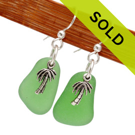 Sorry these green sea glass earring with silver palm tree charms have been sold!