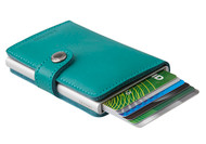 Click Secrid wallet lever and to others amazement, your cards will slide neatly out of the wallet â€_very cool.