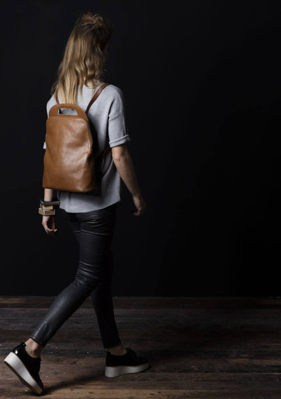 Model wears Ford Backpack Tan from Elk Accessories