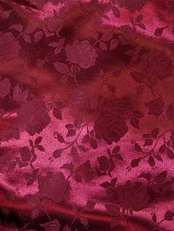 """100% poly washable floral jacquard fabric. High luster soft satin. Perfect for brides maid dress, formal gowns or party decorating fabric for tables, chairs or room decorating. 54"""" wide"""