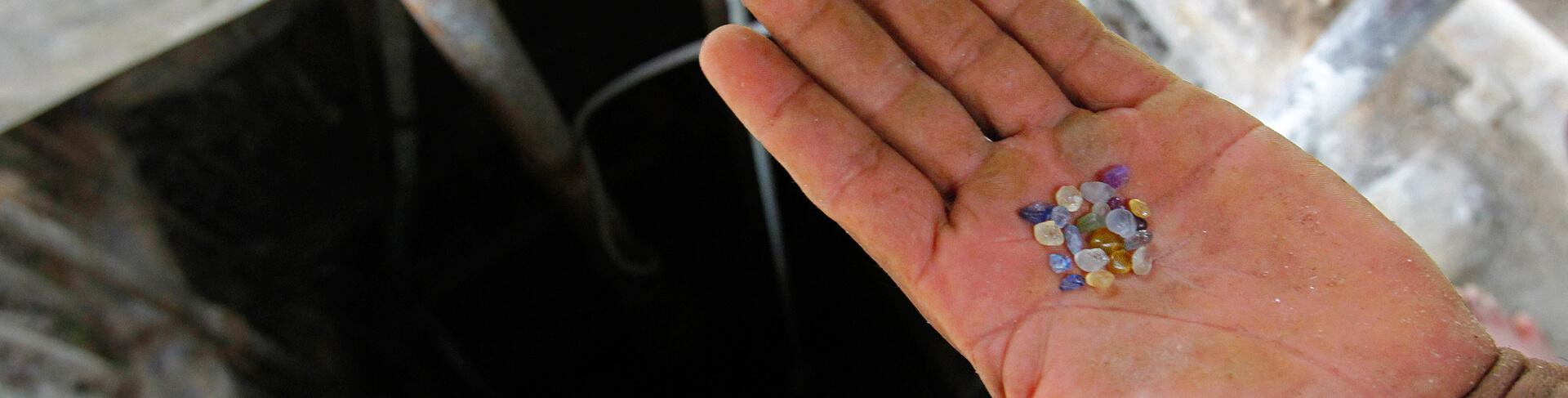 Sri Lankan Sapphire Miner Holding Fair Trade Gems