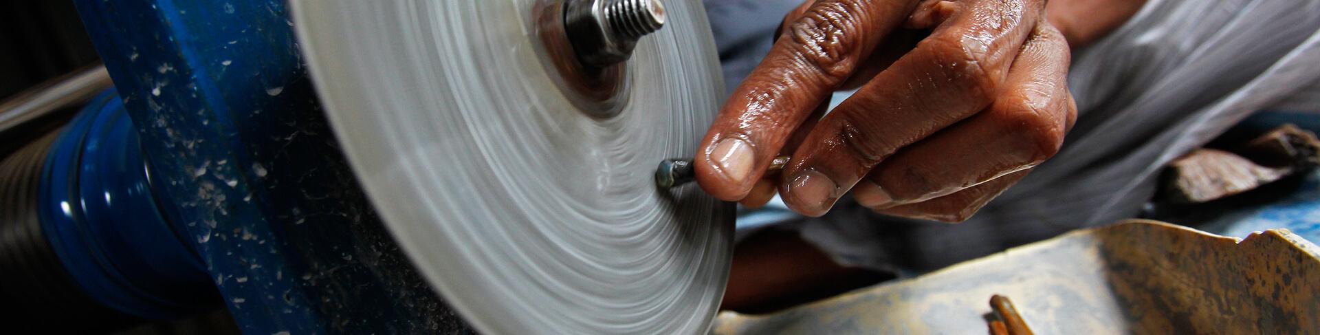 Sri Lankan Sapphire Miner Cutting Gem