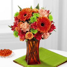 Orange Escape Bouquet by Savilles Country Florist. Flower delivery to Orchard Park, Hamburg, West Seneca, East Aurora, Buffalo, NY and surrounding suburbs.