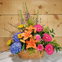 Spring Garden Flower Basket by Savilles Country Florist. Flower delivery to Orchard Park, Hamburg, West Seneca, East Aurora, Buffalo, NY and surrounding suburbs.