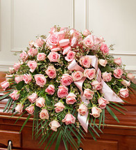 Pink Roses Half Casket Spray by Savilles Country Florist. Flower delivery to Orchard Park, Hamburg, West Seneca, East Aurora, Buffalo, NY and surrounding suburbs.