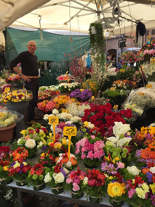 Florist in the street markets of Rome, Italy—Happy Easter from The Flower Lady, Milwaukee Florist!