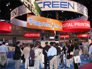 Aero™ hanging banner signs at a trade show