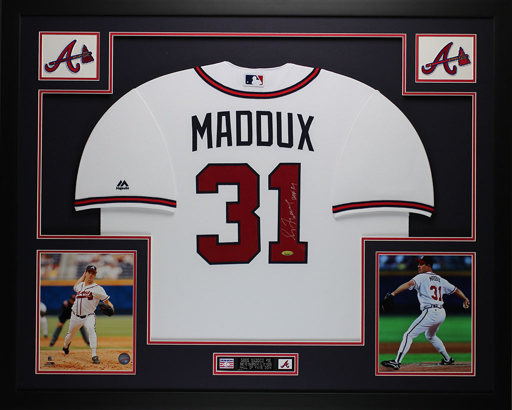 Greg Maddux Autographed and Framed White Braves Jersey