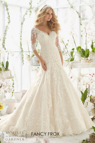 Mori Lee 2812. Alencon lace appliques on net, frosted with delicate beading and scalloped hemline.