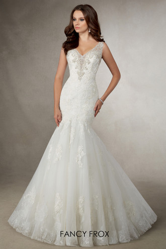 Adele by Ronald Joyce. A fit & flare tulle organza gown with a v-neckline, beaded detail and lace applique back.