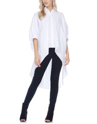 White oversized button front, exaggerated high low top.