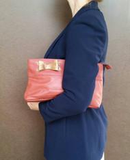 Coral leather clutch handbag - fashion purse with bow -  ivanka