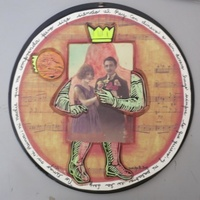 "Brito (Yamilys Brito Jorge) #6136. ""Matrimonio,"" N.D. Mixed media collage on vinyl record. 12 inches diameter"