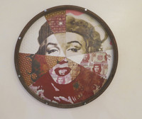 "Adrian Rumbaut,  ""Original multiple,"" 2014. Mixed media, wood & metal. 28"" diameter."