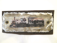 """Dagoberto Driggs Dumois , """"Central Santa Lucia,"""" 2014. Mixed media: wood, metal from abandoned sugar mills and railroad ties in and around Holguin. 12"""" x 25"""" Collection of Sandra Levinson."""