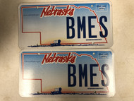 Expired NEBRASKA www . nebraska . gov License Plate BMES PAIR Covered Wagon Ox Prairie