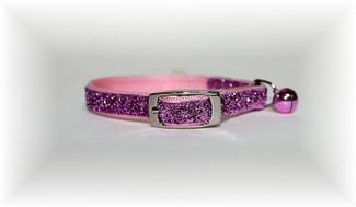 Safety Cat Collar made of strong nylon webbing and covered with a metallic infused glitter fabric and matching bell attached.