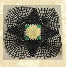 Fancy black metallic web doily