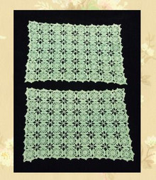 Pair of pale green doilies
