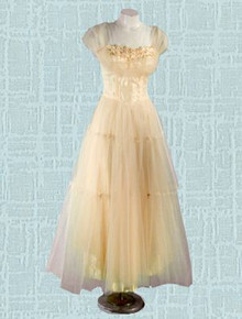 Ivory satin and net ball gown