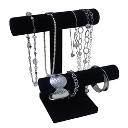 Two-tier jewelry organizer helps display and organize jewelry. Keep necklaces untangled and on display at all times.