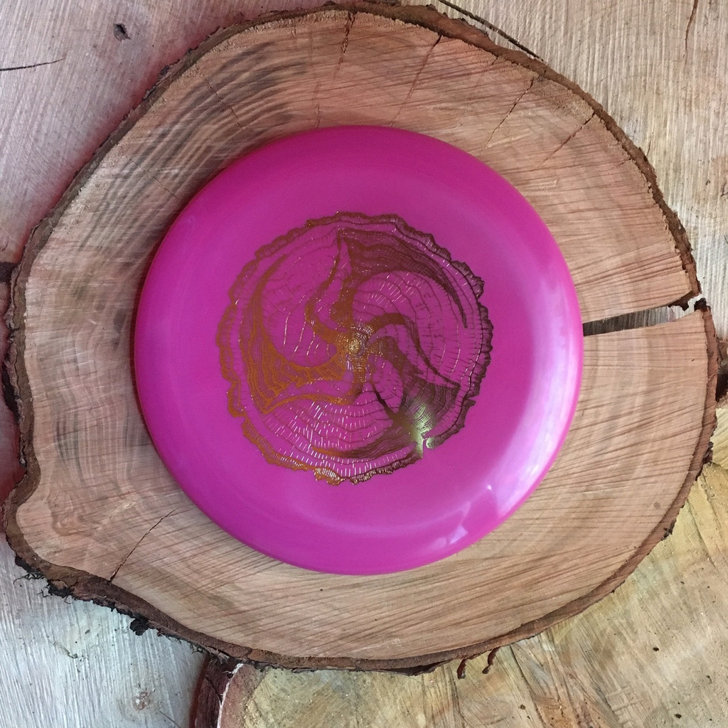 Discmania S-Line P2 pink with a gold Huk Lab Timber stamp