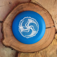 Discmania D-Line P2 blue with a white Huk Lab Timber stamp
