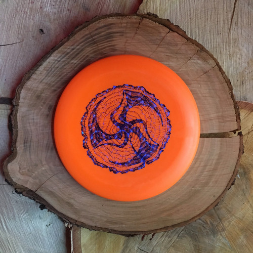 Discmania D-Line P2 orange with a blue Huk Lab Timber stamp