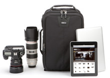 Airport Essentials camera backpack pictured with camera, lens, laptop, and tablet
