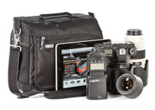 Fits a regular size DSLR and 2-4 standard telephoto lenses.