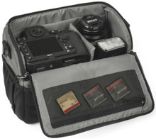 Tradewind Camera Shoulder Bag 6.8 pictured with main compartment opened and DSLR/accessories inside.