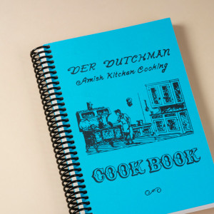 """The cooks of the famed Der Dutchman Restaurant in Walnut Creek, Ohio, know exactly how to put the comfort in comfort food. First published in 1973, this classic cookbook contains fun surprises like """"Never-fail Pie Crust"""", """"Bushel Cookies"""", """"Poor Man's Steak"""", and """"Old-fashioned Butterscotch Pie."""" Along with traditional recipes destined to become dog-eared favorites, you'll find original Pennsylvania Dutch jingles in every chapter.  180 pages. A great stuffer for your Amish Gift Baskets!"""