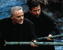 Alec Baldwin & Anthony Hopkins in The Edge a.k.a. Bookworm Poster and Photo